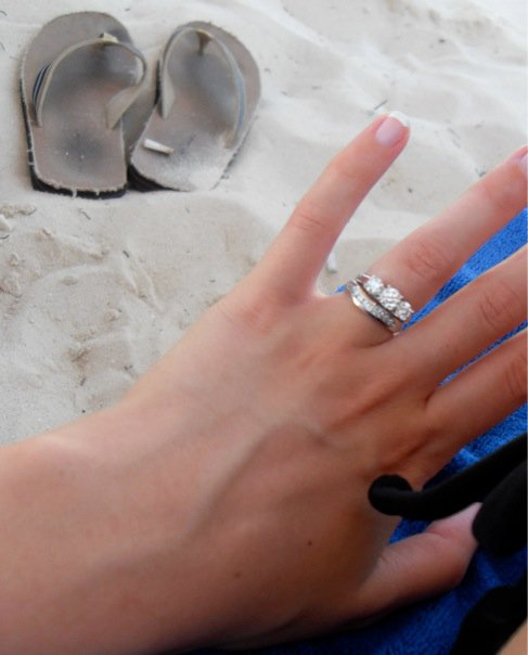 just married ring on beach